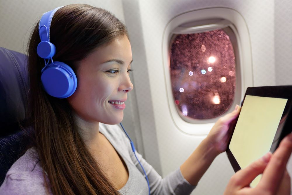 cách đi máy bay không bị ù tai
