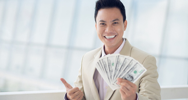 Asian Man With Money Showing Thumbs Up