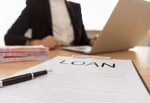 Selective Focus Pen On Business Loan Application Form With Banke